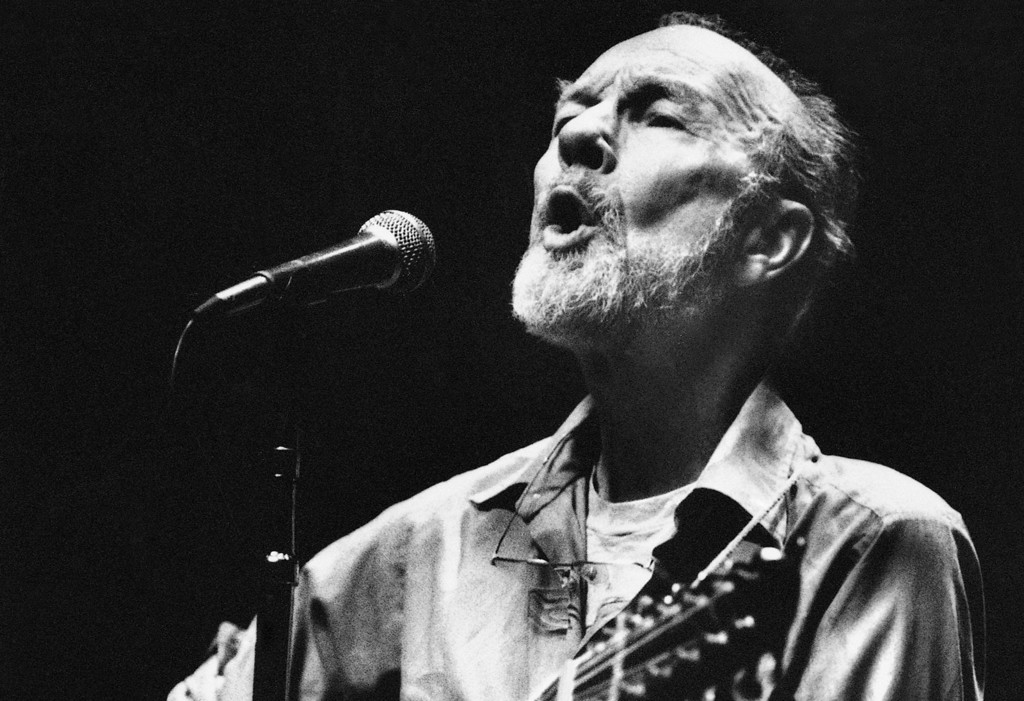 . Folk singer Pete Seeger sings in a one-man benefit concert in Berkeley, Calif., at the Berkeley Community Theater, Feb. 25, 1984. The sold-out concert was a benefit for the San Francisco Folk Music Center, the Woodie Guthrie Foundation and Seeger�s folk music magazine, �Sing Out.� (AP Photo/Mark Costantini)