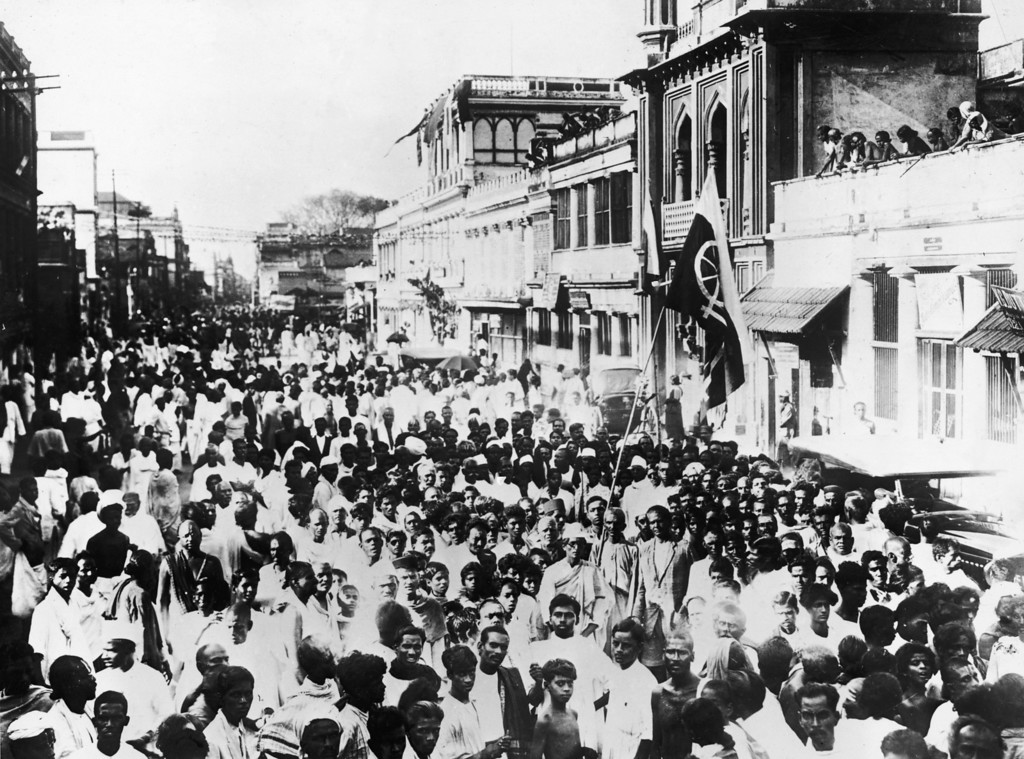 . National volunteers, supporters of Mahatma Gandhi march through the streets of Madras carrying the banner of home rule, 1930.  (Photo by Hulton Archive/Getty Images)