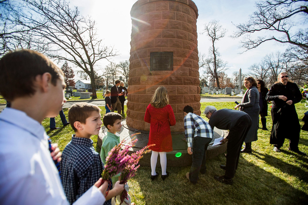 . Friends and family members of passengers killed on Pan Am flight 103, which Libyan terrorists blew up over Lockerbie, Scotland, gather at a memorial cairn to honor the victims in Arlington National Cemetery on the 25th anniversary of the incident in Arlington, Virginia, USA, 21 December 2013. The terrorist act killed 243 passengers and 16 crew members, as well as 11 people on the ground.  EPA/JIM LO SCALZO