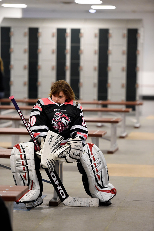 . Girls playing in hockey has become quite popular as Vera Poirier of the Lady Rough Riders takes a seat before their game February 21, 2016 at the Ice Center at the Promenade. The growth of hockey in Colorado has gone up  in the last 20 years since The Avalanche came to town. (Photo By John Leyba/The Denver Post)