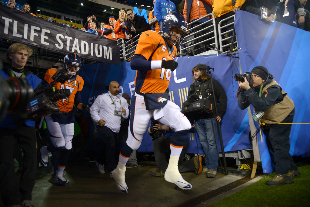 . Denver Broncos quarterback Peyton Manning (18) runs on the field for warmups before the game. The Denver Broncos vs the Seattle Seahawks in Super Bowl XLVIII at MetLife Stadium in East Rutherford, New Jersey Sunday, February 2, 2014. (Photo by John Leyba/The Denver Post)