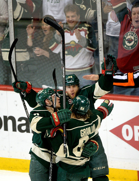. Wild players Zach Parise, Jason Pominville and Mikael Granlund celebrate Granlund\'s goad during the first period.  (Pioneer Press: Sherri LaRose-Chiglo)