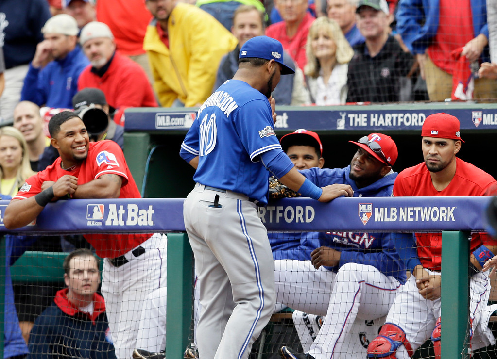 . Toronto Blue Jays\' Edwin Encarnacion talks with Texas Rangers\' Hanser Alberto, center, after catching a Jonathan Lucroy pop out in the seventh inning of Game 2 of baseball\'s American League Division Series, Friday, Oct. 7, 2016, in Arlington, Texas. The Rangers\' Elvis Andrus, left, ad Robinson Chirinos, right, watch. (AP Photo/LM Otero)
