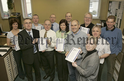 Staff from all branches of the Housing Executive throughout Northern Ireland have recently attended training on site safety to obtain their CITB site pass card. Pictured Mr Lenny McCann (Health matters NI) Presenting Certificates. 06W8N6