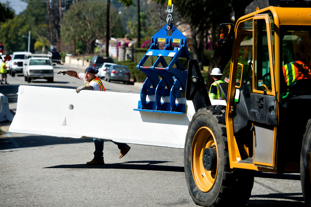 . Workers install K-rails along Sierra Madre Avenue on Tuesday, Feb. 25, 2014 as the City of Glendora prepares for two major rainstorms that will hit the region this week that potentially will cause mudslides in the area devastated by the Colby Fire. (Photo by Watchara Phomicinda/ San Gabriel Valley)