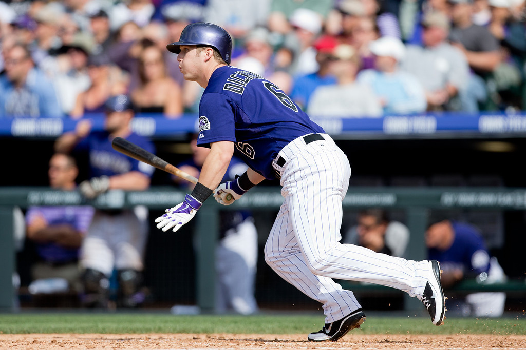 . DENVER, CO - JUNE 7:  Corey Dickerson #6 of the Colorado Rockies watches his game-tying RBI single during the seventh inning against the Los Angeles Dodgers at Coors Field on June 7, 2014 in Denver, Colorado. The Rockies defeated the Dodgers 5-4 in 10 innings to end their eight game losing streak. (Photo by Justin Edmonds/Getty Images)