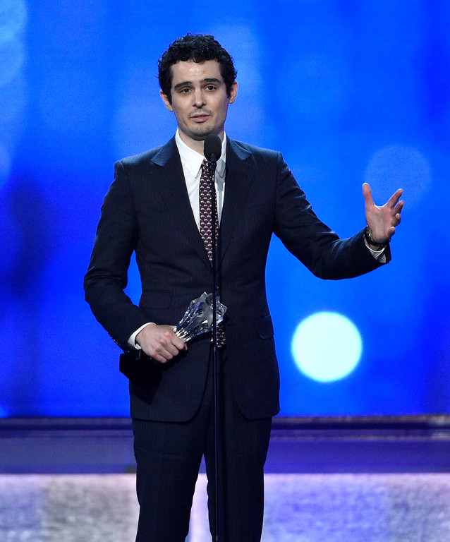 """. Damien Chazelle accepts the award for best director for \""""La La Land\"""" at the 22nd annual Critics\' Choice Awards at the Barker Hangar on Sunday, Dec. 11, 2016, in Santa Monica, Calif. (Photo by Chris Pizzello/Invision/AP)"""