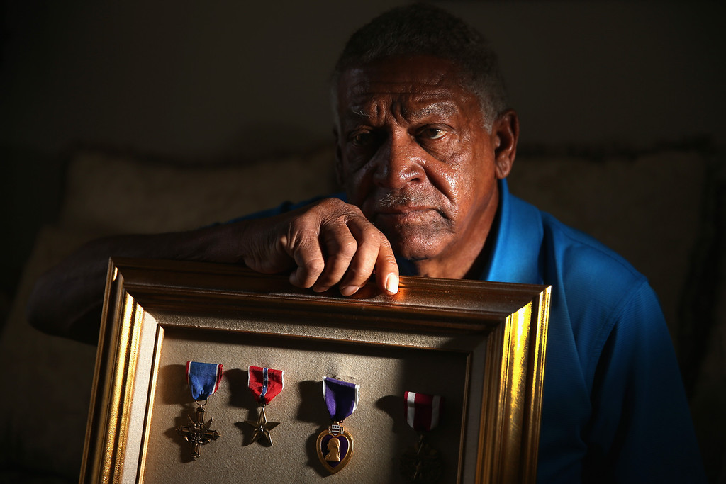 . U.S. Army Staff Sergeant Melvin Morris, a Vietnam War veteran, is seen with some of the medals presented to him during his years of service on March 04, 2014 in Cocoa, Florida.  (Photo by Joe Raedle/Getty Images)