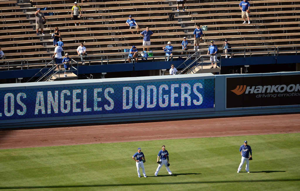 . Los Angeles Dodgers shag fly baseballs in the outfield prior to a Major league baseball game between against the San Diego Padres on Saturday, July 12, 2014 in Los Angeles.   (Keith Birmingham/Pasadena Star-News)