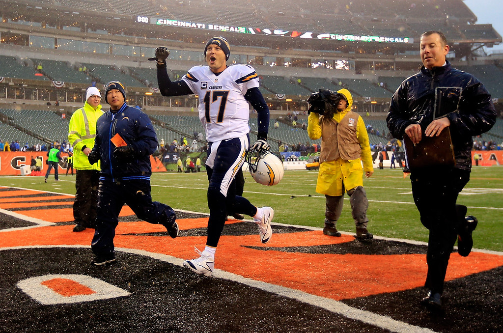 . Quarterback Philip Rivers #17 of the San Diego Chargers celebrates on the field after defeating the Cincinnati Bengals 27-10 in a Wild Card Playoff game at Paul Brown Stadium on January 5, 2014 in Cincinnati, Ohio.  (Photo by Rob Carr/Getty Images)