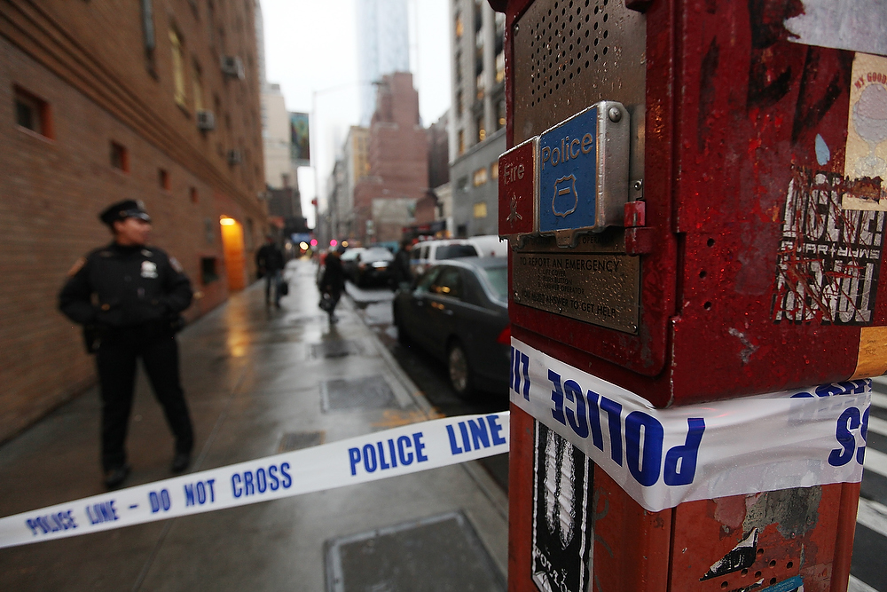 Description of . Police cordon off the scene of a fatal shooting at 202 West 58th Street in Manhattan on December 10, 2012 in New York City.  The victim, identified as a male was shot in the head in broad daylight on the sidewalk and has since been pronounced dead.  (Photo by Mario Tama/Getty Images)