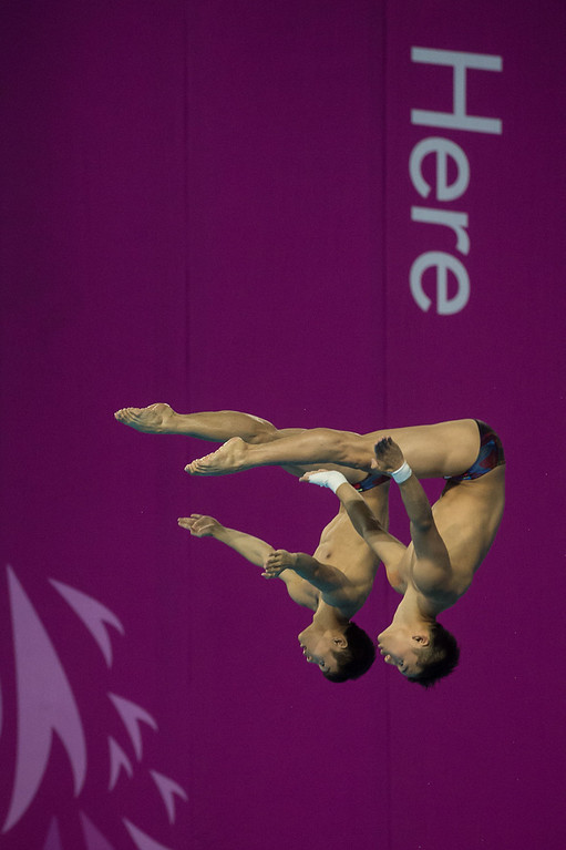. Chen Aisen and Zhang Yanquan of China compete in the men\'s 10m springboard final diving event of the 17th Asian Games in Incheon on September 29, 2014.  ED JONES/AFP/Getty Images