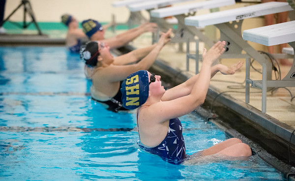 10/02/19 Wesley Bunnell | StaffrrBulkeley/HMTCA girls swimming at Newington on Wednesday afternoon. Julia Reniszewski, front, at the beginning of the 100 yard backstroke.