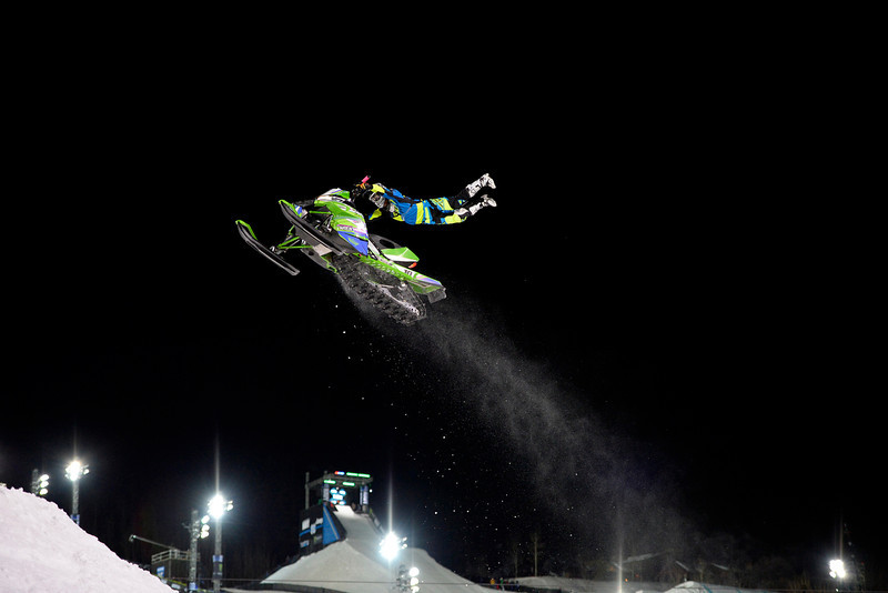 . Willie Elam does a trick at the Snowmobile Freestyle Practice in Aspen at Winter X Games in Aspen, January 22, 2014. The Snowmobile Freestyle Final will be held Thursday night on Buttermilk Mountain. 