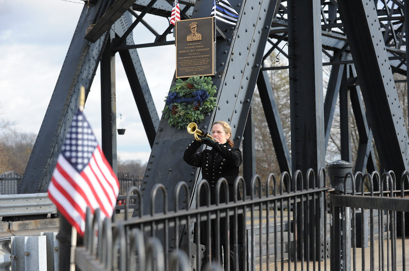 """Joan Caffrey Stocker, of Phillipsburg, played TAPS. The Phillipsburg Police Department held a remembrance ceremony honoring fallen officer, Kenneth W. """"Red"""" Vandegrift who died in the line of duty Nov. 20, 1930. The ceremony was at the bridge on South Main Street that bears his name."""