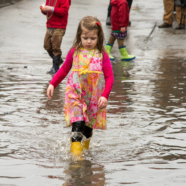 Have boots, will wade through the deep waters at the end of the 2018 Mead Rd. Mardi Gras parade in Decatur