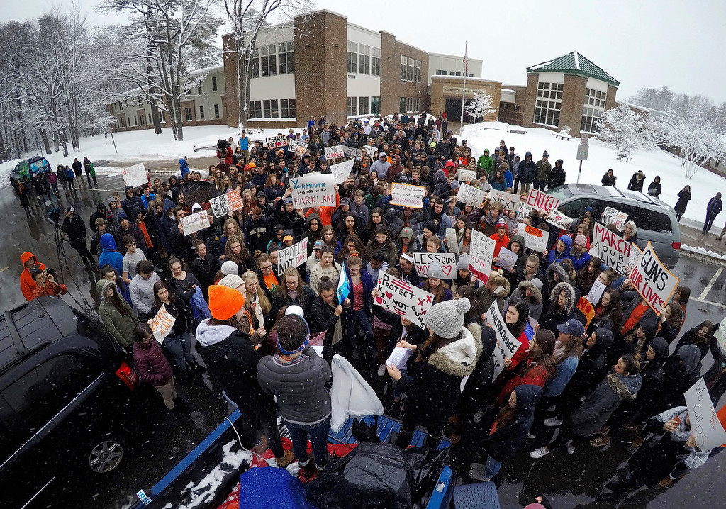 . Students at Yarmouth High School participate in a walkout to protest gun violence, Wednesday, March 14, 2018, in Yarmouth, Maine. Leaders of the rally address the crowd from the back of a pick-up truck in front of the school. Yarmouth is one of the few schools in Maine that did not cancel school on Wednesday as the state digs out from the third major winter storm in two weeks. (AP Photo/Robert F. Bukaty)