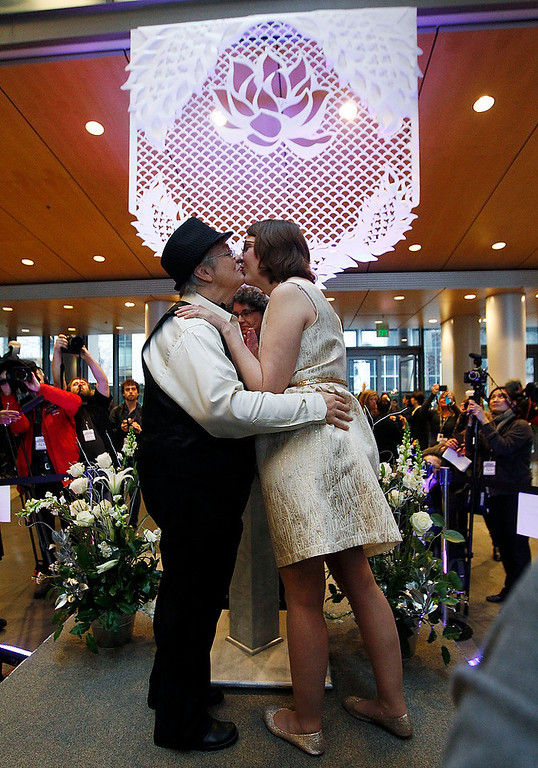 . Katherine, left, and Karen, who both declined to provide their last names, kiss at the conclusion of their wedding ceremony at Seattle City Hall, becoming among the first gay couples to legally wed in the state, Sunday, Dec. 9, 2012, in Seattle. (AP Photo/Elaine Thompson)
