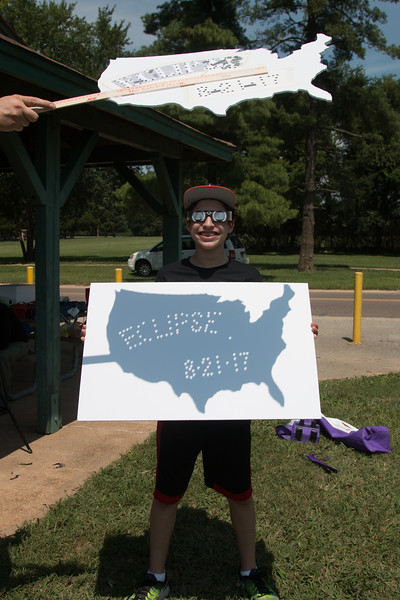 Rafael holds a poster board onto which is projected a US map. Notice that each dot on the board shows the eclipse! -- Total solar eclipse, Buder Park, southwest St. Louis County, MO, Aug 21, 2017.