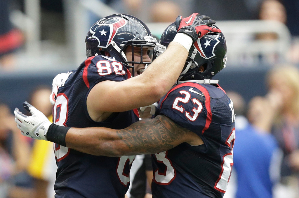 . Houston Texans\' Garrett Graham (88) celebrates with teammate Arian Foster (23) after he scored a touchdown during the first quarter an NFL football game against the Seattle Seahawks, Sunday, Sept. 29, 2013, in Houston. (AP Photo/Patric Schneider)