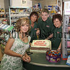 Spar Bessbrook 1st Anniversary on Friday last, cutting the cake, Prop. Brian Cosgrove, and customer,Bridgeen Kean, staff Mary Edgar,Tina Kimberly. 07W23N22
