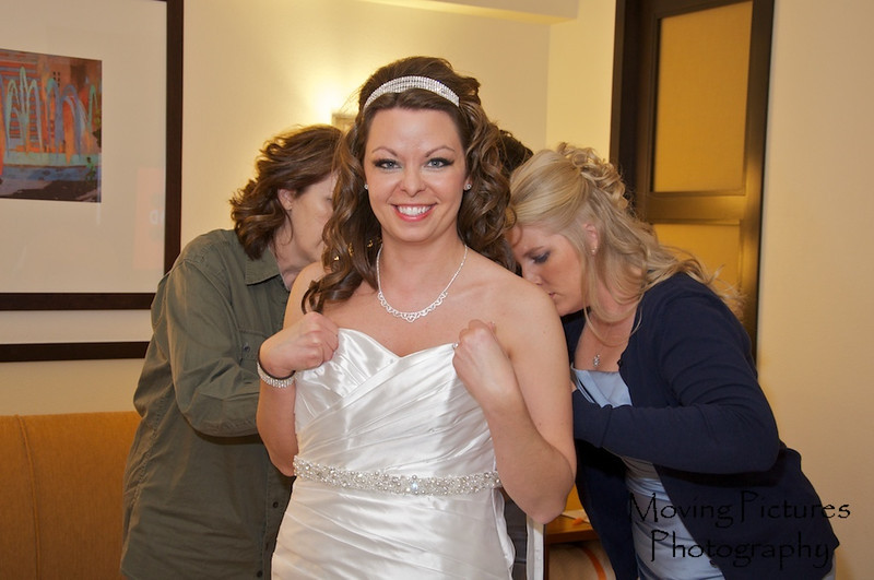 Erin & Evan Wedding - donning the gown