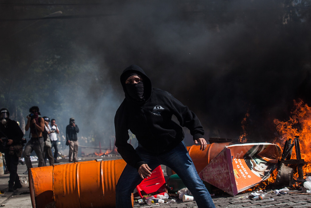 . Demonstrators from the anarchist group Black Bloc clash with police during the protest against the holding of the World Cup on the opening day of the event on June 12, 2014 in Sao Paulo, Brazil. (Photo by Victor Moriyama/Getty Images)