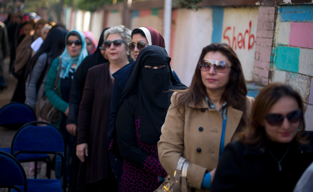 . Egyptian women line up to vote in the country\'s constitutional referendum in Cairo, Egypt, Wednesday, Jan. 15, 2014. Undeterred by a day of sporadic violence, Egyptians are lining up to vote on the second, final day of a key referendum on a new constitution. (AP Photo/Khalil Hamra)