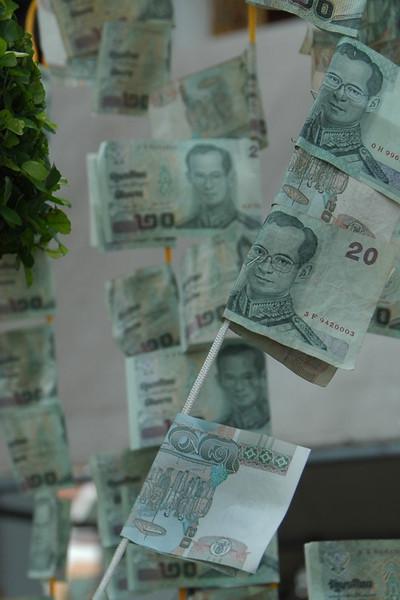 Money Offerings at Wat Arun - Bangkok, Thailand