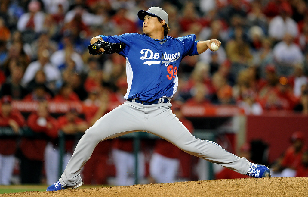 . Los Angeles Dodgers starting pitcher Hyun-Jin Ryu throws to the plate in the third inning of a spring baseball game against the Los Angeles Angels on Thursday, March 28, 2012 in Anaheim, Calif.   (Keith Birmingham/Pasadena Star-News)