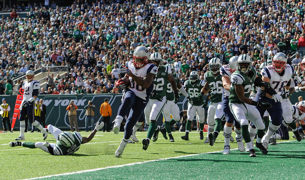 . Running back Brandon Bolden #38 of the New England Patriots runs for a touchdown in the 1st quarter against the New York Jets at MetLife Stadium on October 20, 2013 in East Rutherford, New Jersey. (Photo by Ron Antonelli/Getty Images)