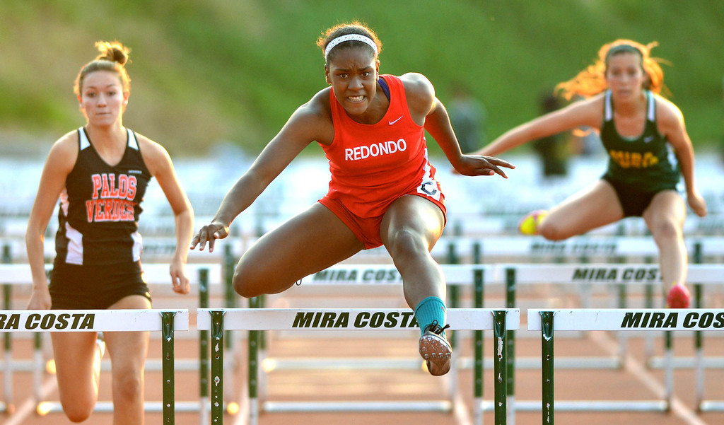 . 05-03-2013-(LANG Staff Photo by Sean Hiller)-  The Bay League track and field finals Friday night at Mira Costa High School. Kristen Hamlin of Redondo wins the girls varsity 100 meter hurdles.