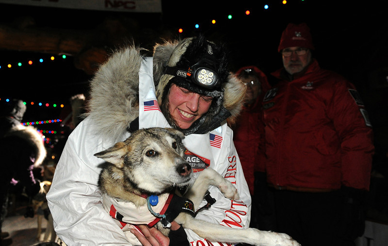 . Aliy Zirkle holds her lead dog after finishing in second place behind race winner Dallas Seavey in the 2014 Iditarod Trail Sled Dog Race, Tuesday, March 11, 2014 in Nome, Alaska.  (AP Photo/The Anchorage Daily News, Bob Hallinen)