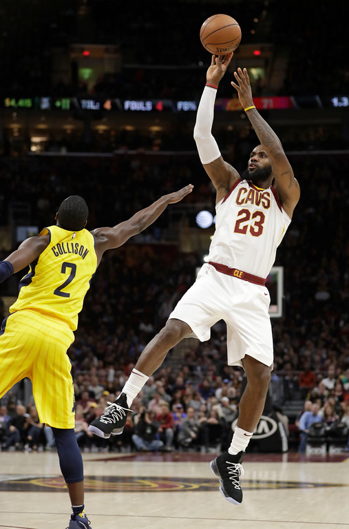 . Cleveland Cavaliers\' LeBron James (23) shoots over Indiana Pacers\' Darren Collison (2) during the first half of an NBA basketball game Friday, Jan. 26, 2018, in Cleveland. (AP Photo/Tony Dejak)