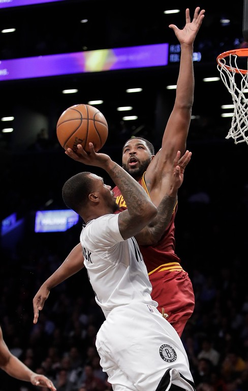 . Cleveland Cavaliers\' Tristan Thompson, above, defends Brooklyn Nets\' Sean Kilpatrick during the second half of an NBA basketball game Friday, Jan. 6, 2017, in New York. The Cavaliers won 116-108. (AP Photo/Frank Franklin II)