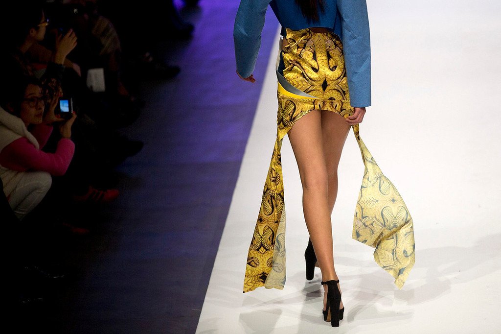 . A model presents a creation by Chinese designer Li Pengfei during the Huafu Cup fashion design contest at China Fashion Week in Beijing Monday, Oct. 28, 2013. (AP Photo/Andy Wong)