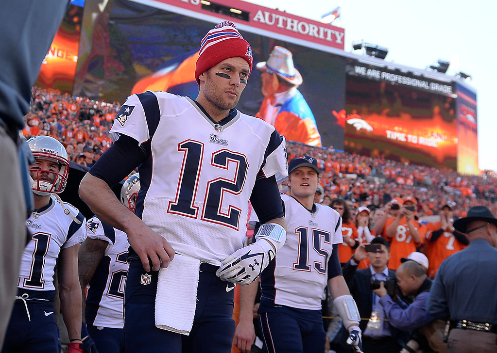 . New England Patriots quarterback Tom Brady (12) takes the field before the game. The Denver Broncos take on the New England Patriots in the AFC Championship game at Sports Authority Field at Mile High in Denver on January 19, 2014. (Photo by AAron Ontiveroz/The Denver Post)