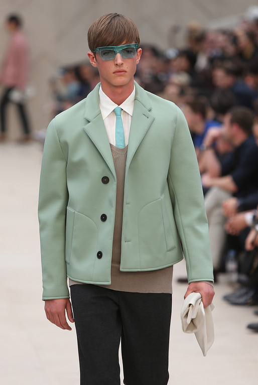 . A model wears a creation by Burberry during London Men\'s spring summer fashion collections 2014, in London, Tuesday, June 18, 2013. (Photo by Joel Ryan/Invision/AP)