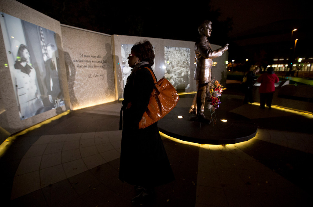 . Brenda Murphy of Fort Worth pauses at the JFK Tribute outside the Hilton Hotel on the 50th anniversary of the John F. Kennedy\'s assassination, Friday, Nov. 22, 2013.  The 50th anniversary is being marked today in Dallas, where Kennedy was shot, and elsewhere in the United States and overseas.  (AP Photo/The Fort Worth Star-Telegram, Joyce Marshall)