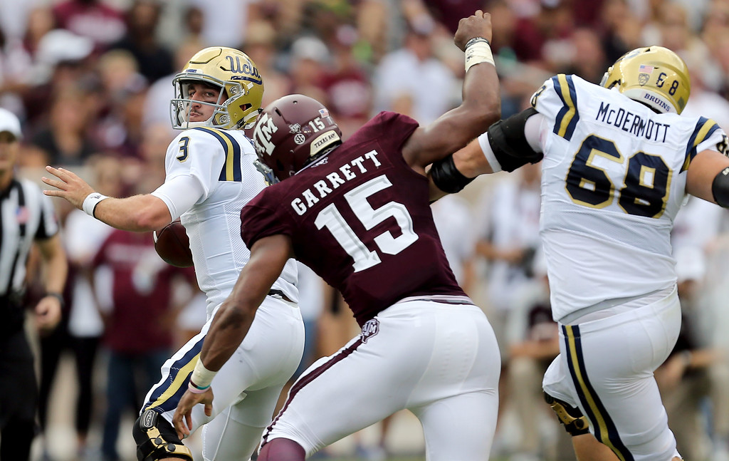 . UCLA quarterback Josh Rosen (3) is pressured by Texas A&M Myles Garrett (15) during the first quarter of an NCAA college football game Saturday, Sept. 3, 2016, in College Station, Texas. (AP Photo/Sam Craft)