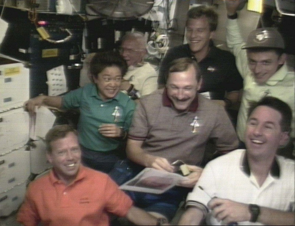 ". The crew of the space shuttle Discovery have a laugh after removing ""John Glenn masks\"" for a special halloween video download from aboard the orbiter Saturday, Oct. 31, 1998 in this image from television. Clockwise from left: Steve Lindsey, Japanese Astronaut Chiaki Makai, John Glenn, Scott Parazynski, Spanish Astronaut Pedro Duque, Stephen Robinson and Curt Brown in center.  (AP Photo / NASA TV)"