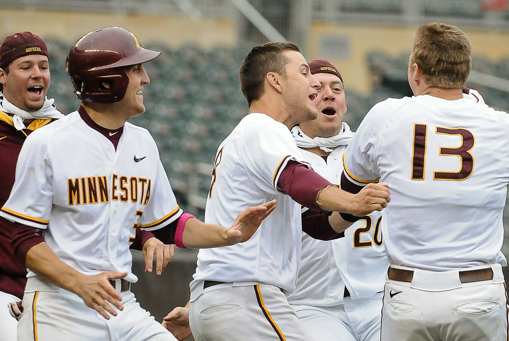 . Minnesota players swarm Andy Henkemeyer, right, after he knocked in the winning run. (Pioneer Press: Ben Garvin)