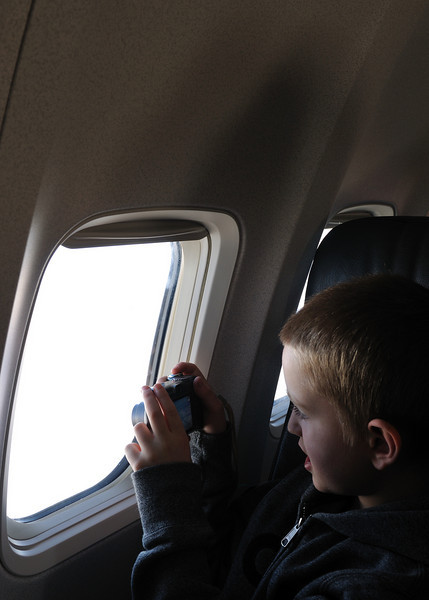 Conor shooting pictures out the airplane window