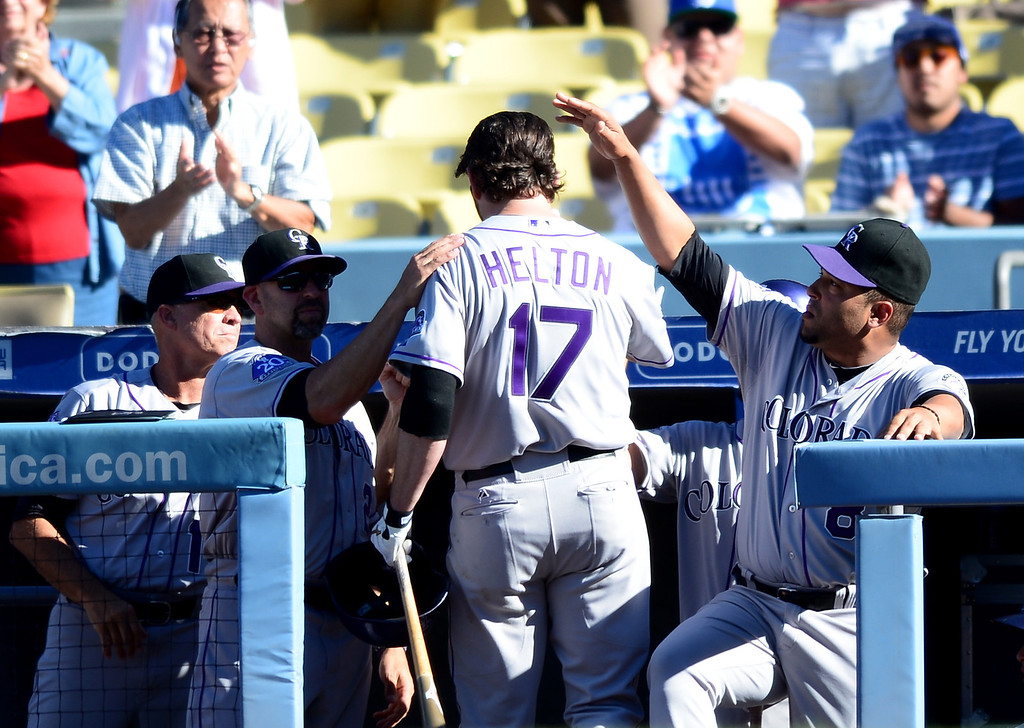 . Rockies\' Todd Helton comes off the field after his final at bat in the last game of a 17 year career at Dodger Stadium during the final game of the regular season Sunday, September 29, 2013. Helton is retiring after 17 seasons. (Photo by Sarah Reingewirtz/Pasadena Star-News)