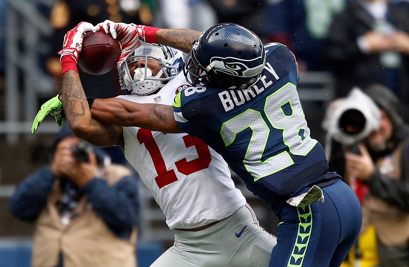 . Wide receiver Odell Beckham Jr. #13 of the New York Giants catches a pass on defensive back Marcus Burley #28 of the Seattle Seahawks during the second quarter of the game at CenturyLink Field on November 9, 2014 in Seattle, Washington.  (Photo by Otto Greule Jr/Getty Images)