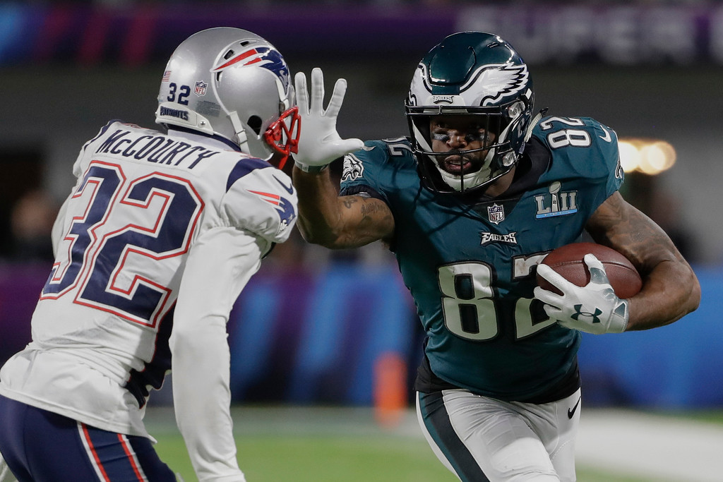. Philadelphia Eagles wide receiver Torrey Smith (82) runs against New England Patriots free safety Devin McCourty (32), during the second half of the NFL Super Bowl 52 football game, Sunday, Feb. 4, 2018, in Minneapolis. (AP Photo/Chris O\'Meara)