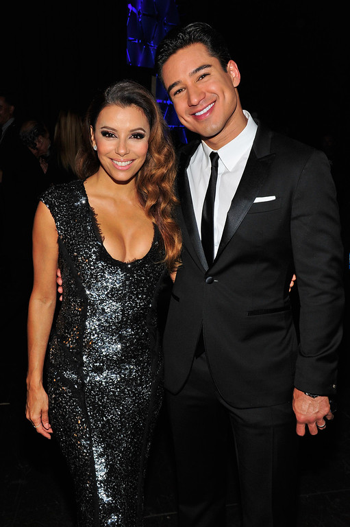 . PASADENA, CA - SEPTEMBER 27:  Hosts Eva Longoria (L) and Mario Lopez pose backstage during the 2013 NCLR ALMA Awards at Pasadena Civic Auditorium on September 27, 2013 in Pasadena, California.  (Photo by Jerod Harris/Getty Images for NCLR)