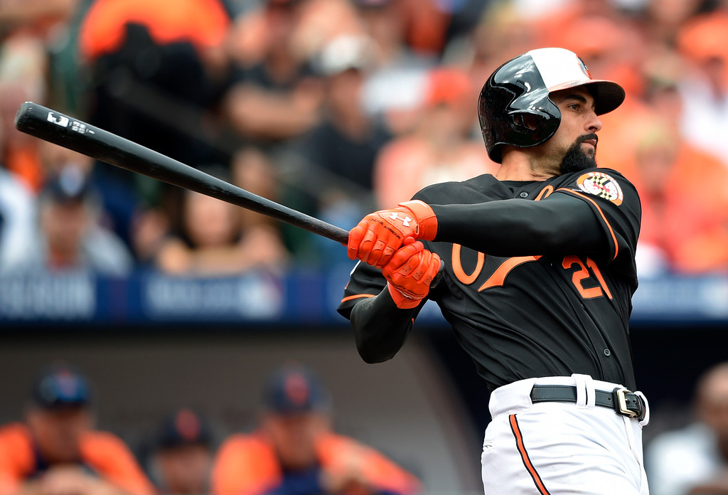 . Baltimore Orioles\' Nick Markakis watches his two-run home run in the third inning of Game 2 in baseball\'s AL Division Series against the Detroit Tigers in Baltimore, Friday, Oct. 3, 2014. (AP Photo/Nick Wass)