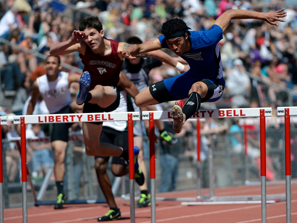 . LITTLETON, CO. - APRIL 27TH: Jordan Charles, Grandview High School, right, and Garrett Lane, left, Chatfield High School, battle the boys 110 meter hurdles during the Liberty Bell Track Meet at Littleton Public Schools Stadium Saturday, April 27th, 2013. Charles won the event. (Photo By Andy Cross/The Denver Post)