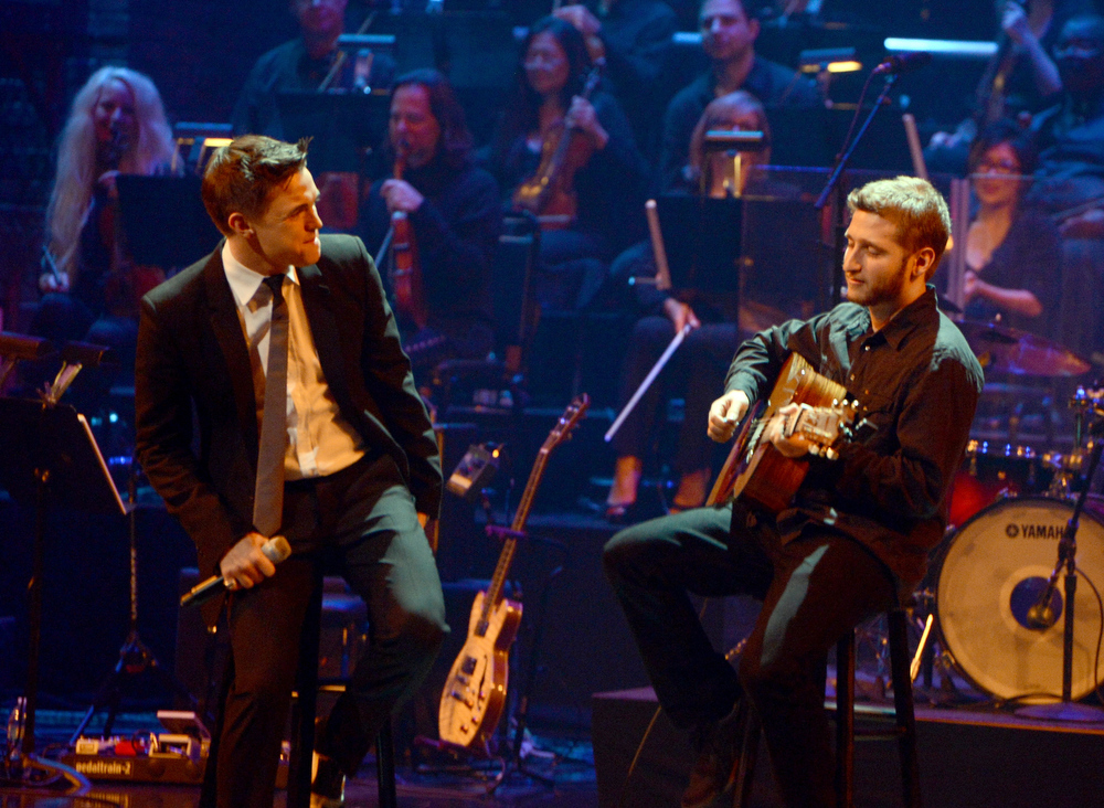 Description of . Singer Jesse McCartney (L) performs onstage during a celebration of Carole King and her music to benefit Paul Newman's The Painted Turtle Camp at the Dolby Theatre on December 4, 2012 in Hollywood, California.  (Photo by Michael Buckner/Getty Images for The Painted Turtle Camp)